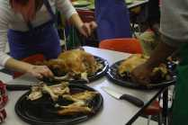 Elena Zuber (12) and Mikel Jordan (12) carve the turkey. Photo by Destony Curry