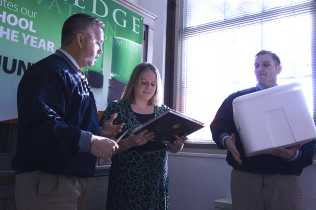 Representatives Chris Heiby and Greg Guthrie present the book and ice cream to congratulate the award-winning teacher of the year Allison Hunt on November 28, 2012.
