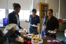 Deciding on what food they want to aquire on their plates, Taylor Browning (11), Shriya Ganti (11), and Amy Ritchie (english) look at the food. Photo by Molly Loehr.