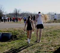 John Oliver (12) and Lilly Moore (12) discuss the meet as they walk back towards their station.