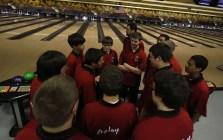 Kiefer Hillerich (12) leads the boys in a pre-game speech.