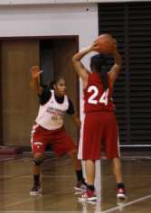 Erika Hawkins guards Destiny Curry as she looks for a teammate to pass the ball.