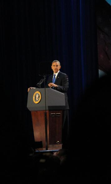 President Barack Obama stands amid applause during his victory speech.