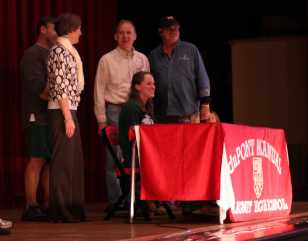 Elizabeth House, (12) signs her letter of intent to swim at the University of Notre Dame.