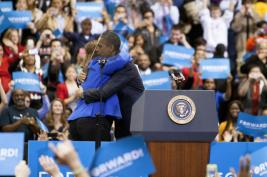 President Barack Obama hugs Julie Walulik. She introduced the President by explaining how his Affordable Care Act helped her son who was born with health complications. Photo by Yazmin Martinez.