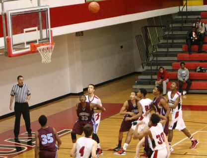 Dwayne Sutton (10) shoots long two-point jumper. Photo By: Alexis Weaver