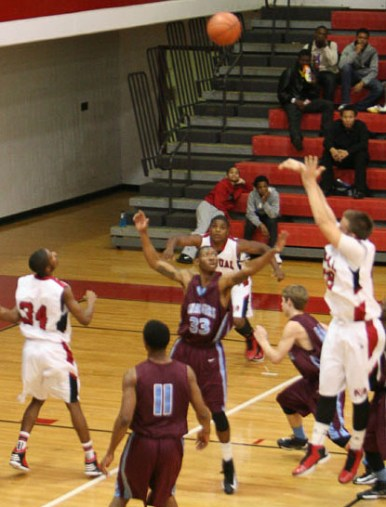 Simon Clifford (12) shoots a long two-point jumper. Photo By: Alexis Weaver