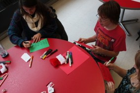 Catherine Sar (11) and Davis Hale (11) collaborate on their holiday cards.