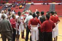 The Crimsons gather during a timeout in the first quarter.