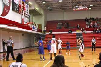 Jaeda Keifer-Coffey (9, #15) shoots a free-throw