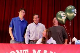Love (12) signs to swim at Michigan State.
