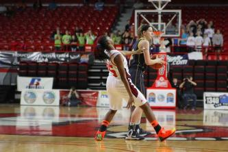 Aricka Prentice (#25, 10) jerks back after a close call with the Notre Dame player's elbow.