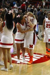 Maci Babbage (12) tries to comfort Long after the final buzzer.