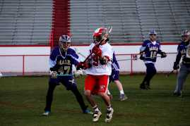 #19 (Ben Speelman) dodges Male's team members as he travel down the field for a shot on Male's goal.