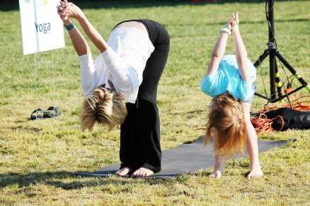Child imitates lady giving instructions on stances.