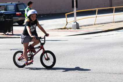 Little girl slows down to let her family catch up with her speed.