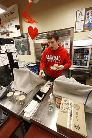 Ben Hachten (12) grabs more rolls.