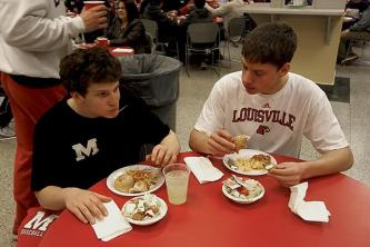 Connor Kriz (12) takes a break from the work to eat.