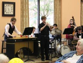 Several members of the jazz band perform a piece at the prom.