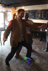 Mr. Wright dances with aid, Omar Mostafa(11).