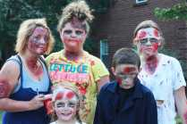 A group of zombie children, show some emotion from their half alive smiles.