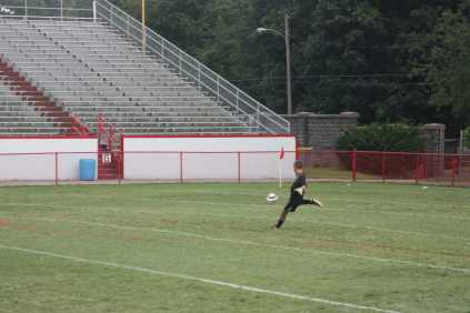 The keeper, Andrew Hagan (10, #1) punts the ball