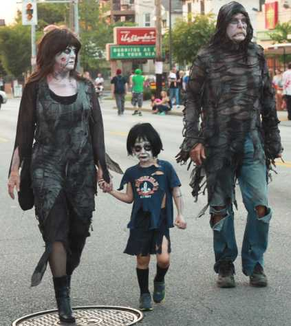 Just enjoying some undead company, zombie family walking down the road.