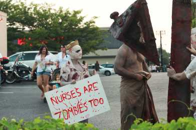 Some zombies even when undead still feel passionately about certain topics. Zombies walk around advocating zombie nurses.