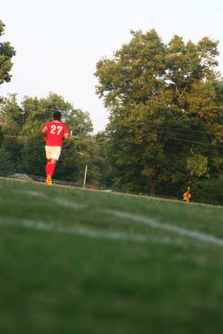 Isaac Domenech (11, #27) jogs to his position on the field