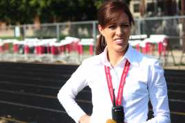 Ms. Amy Medley walks around football field and make sure everyone is their correct place.