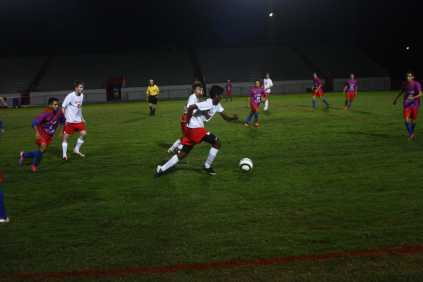 Neel Sandella (10, #35) rushes to goal after being knocked down and regaining possession of the ball