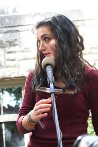 Luisa Powell (12) does a quick microphone check before her band performs at Ramstock. Photo by Julia Nguyen