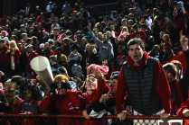 Manual's student section runs from the stands to the edge of the field to celebrate their victory.