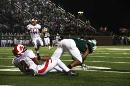 Tyrone Howard (#3) pulls down Trinity player to stop his run.