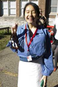 Dressed as the grandma from Mulan, Vanderly Dang (12, J&C) was walking around with her lucky cricket. Photo by Olivia Cook