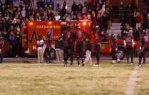 During the second quarter, Courier Journal photographer David Lutman was taken to the hospital after receiving a leg injury in the sidelines.