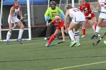 Ellie Wheatley (7, 9) defends the cage with a CAL shot on goal. Photo by Mr. Bowman