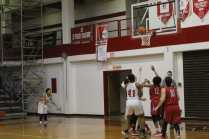 Tyonne Howard (12, 12) making a goal during the girls basketball game. Photo by Cicada Hoyt