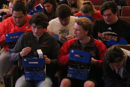 Nickolas Kopp and Lukas Motley opening up their new virtual reality headsets. Photo by Cicada Hoyt.