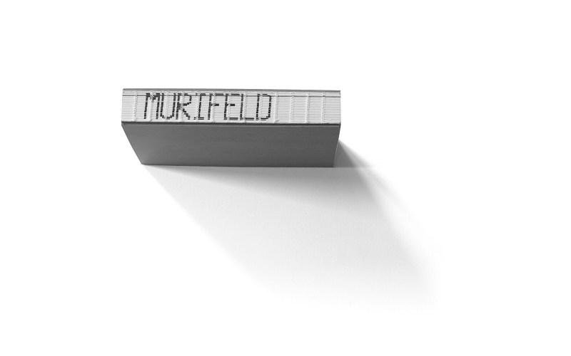 Grafik, Murifeldbuch – Buchrücken mit Schriftzug «Murifeld», gesetzt aus den Flattermarken
