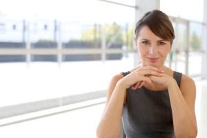 Portrait of attractive businesswoman sitting in modern building