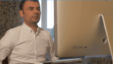 guy sitting in front of a computer
