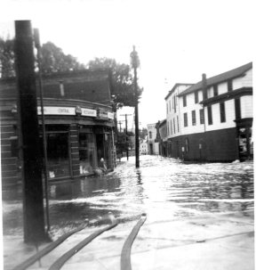 This view from the fire station looks west down Asnuntuck Street, toward the Connecticut River. The fire hoses were used in pumping out the station.