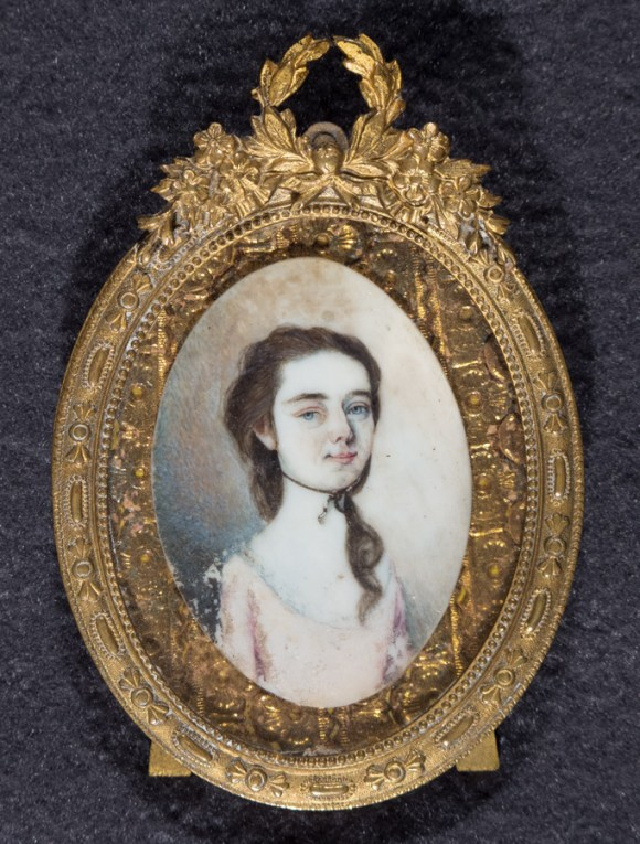 Miniature portrait of young girl, on ivory, in gold frame.
