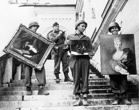 American GIs, under direction of a MFAA officer, retrieve stolen paintings hidden in a German castle at war's end. National Archives Photograph