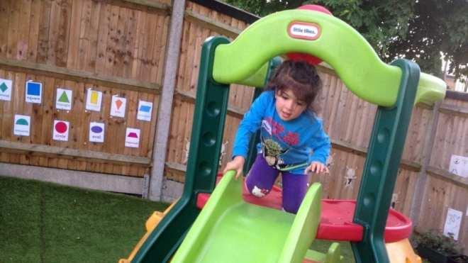 Girl on nursey slide