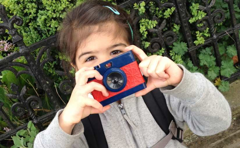 Girl with a Spider-Man camera toy