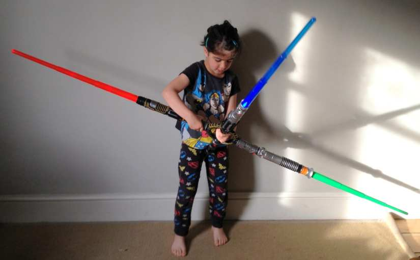 Star Wars Blade Builders Spin Action Lightsaber, girl with lightsaber toy