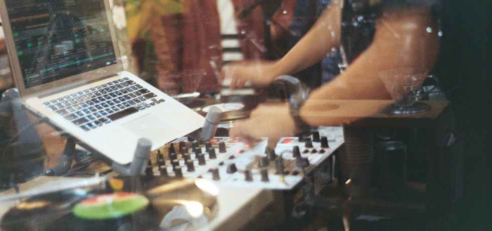 person using audio mixer controller