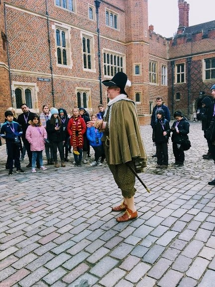 Costumed guide giving a tour of Hampton Court Palace